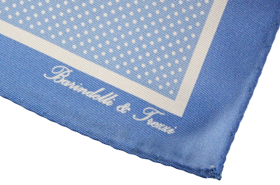 Classic silk handkerchief with white polka dot print on a light