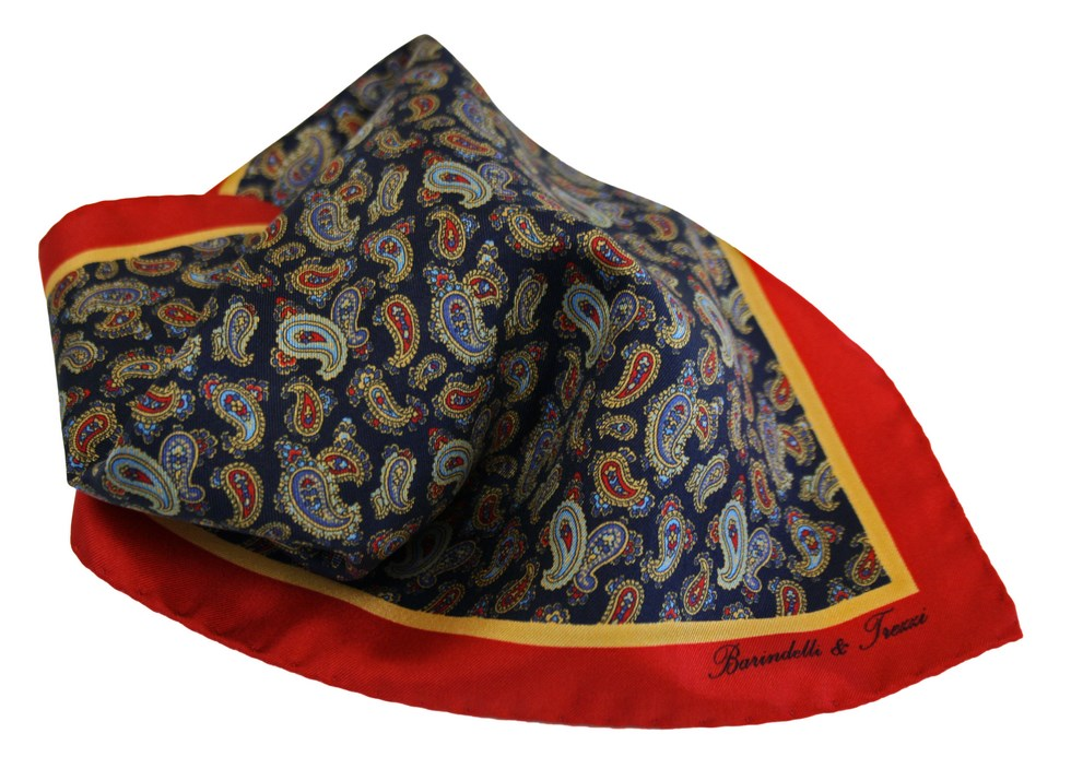 Silk pochette with blue, red and yellow paisley pattern.